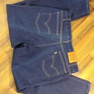 Vintage orange tab Levi's action jeans.